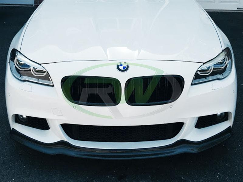 BMW F10 550i in white with an RW Arkym Style Carbon Fiber Front Lip