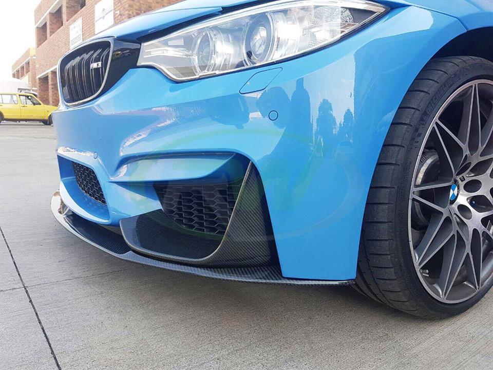 Yas Marina Blue BMW F82 M4 with an RW Perf Style Carbon Fiber Front Lip Spoiler