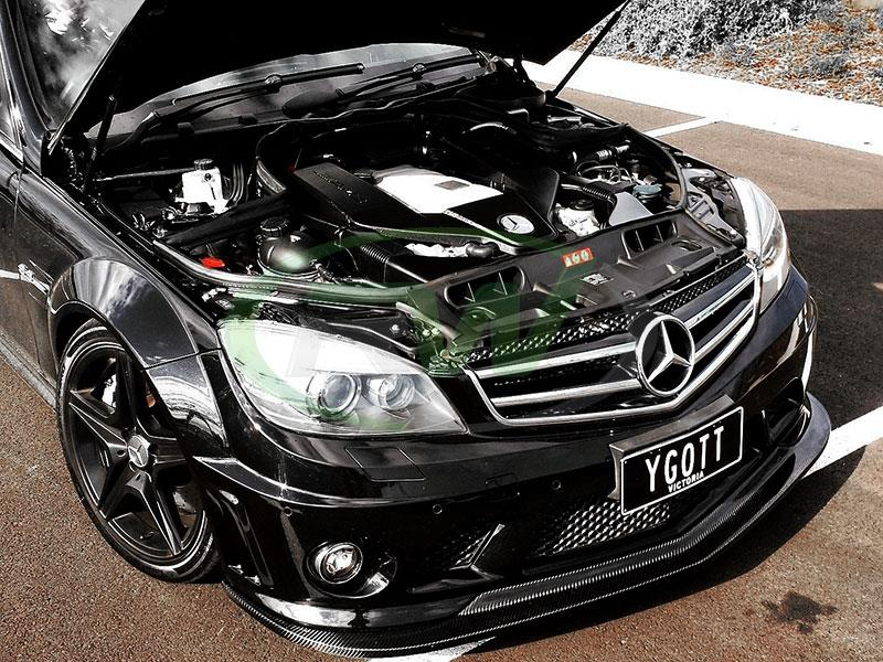 Black 2009 w204 c63 amg fitted with rw carbon fiber front lip, arkym style.