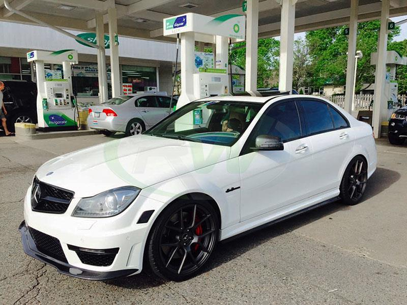 white mercedes w204 c63 with an rw black series style carbon fiber front lip