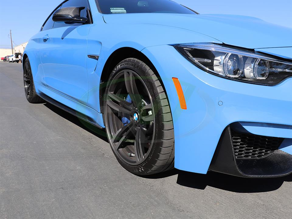 RW Carbon Fiber Side Skirt Extensions on a Yas Marina Blue BMW F82 M4
