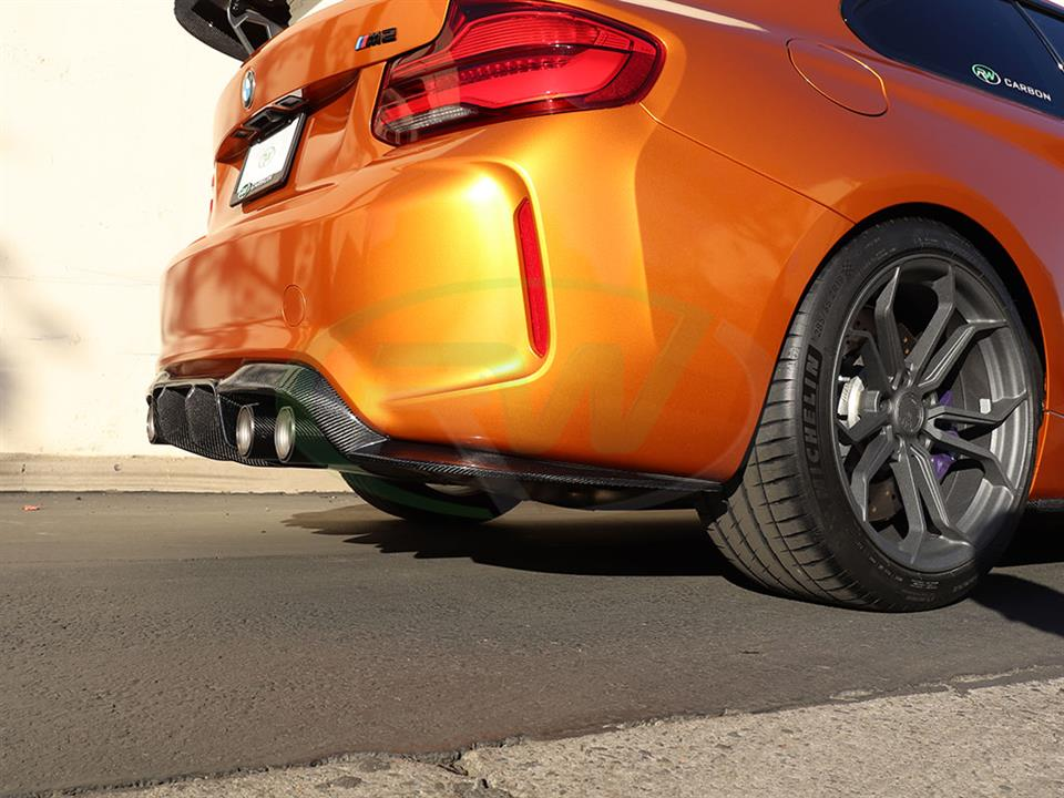 An Orange BMW F87 M2 has a new DTM Carbon Fiber Diffuser