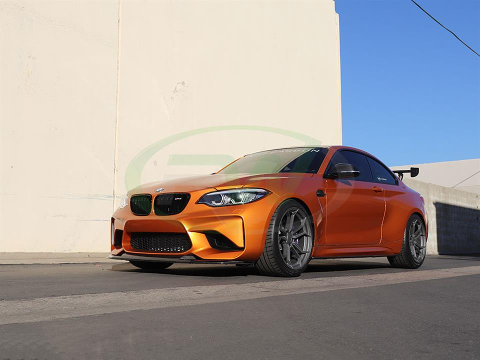 Orange BMW F87 M2 gets an RW GTS Style Carbon Fiber Front Lip