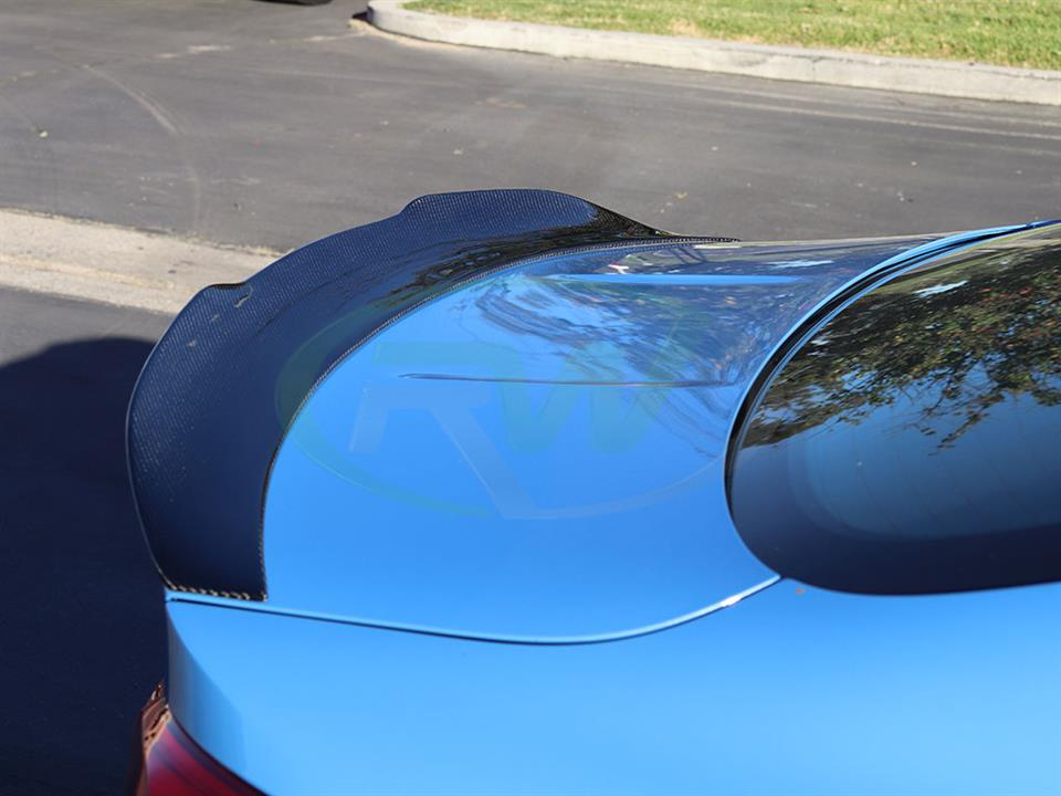 Another Yas Marina Blue BMW M4 gets a GTX CF Trunk Spoiler