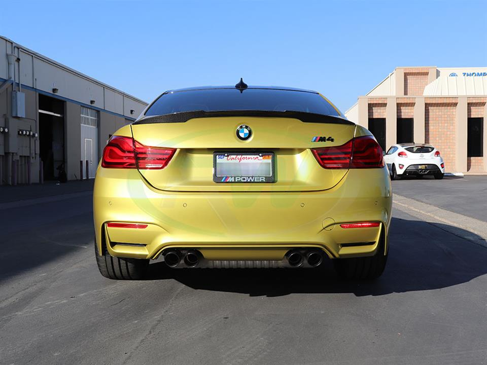 An Austin Yellow BMW F82 M4 gets a new Perf Style Trunk Spoiler