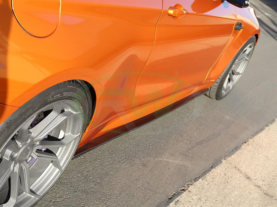 An Orange BMW F87 M2 with RW Carbon Fiber Side Skirt Extensions