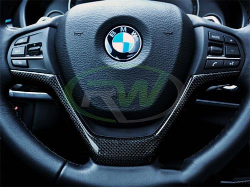 Carbon fiber steering wheel trim for the BMW F15 X5 and F16 X6.