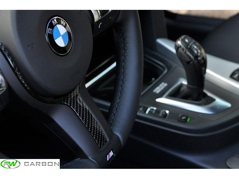 Get a unique interior look and feel with the RW Carbon BMW Steering Wheel Trim