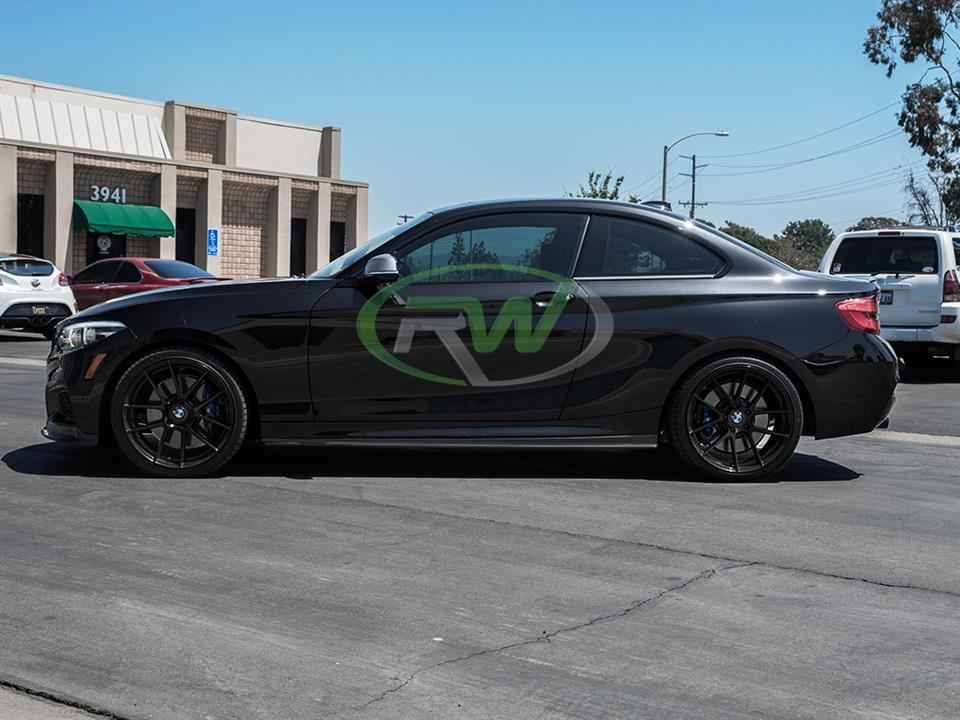 black bmw f22 m240i 2 series with rw carbon fiber cf side skirt extensions