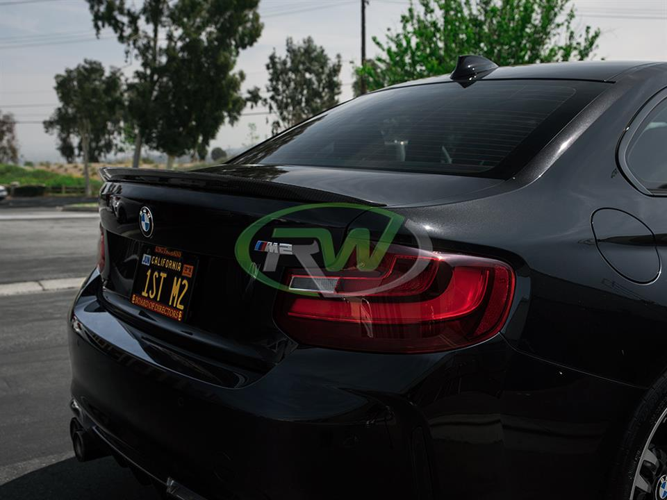 black bmw f87 m2 with rw carbon fiber performance style cf trunk spoiler