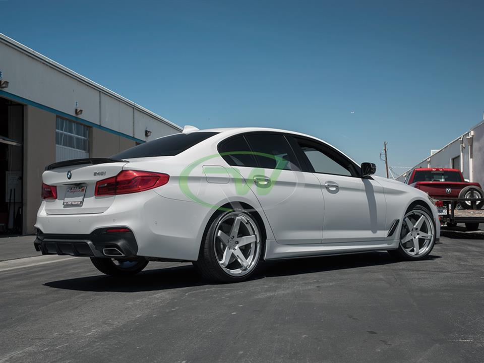 white bmw g30 540i 5 series with rw carbon fiber cf side skirt extensions