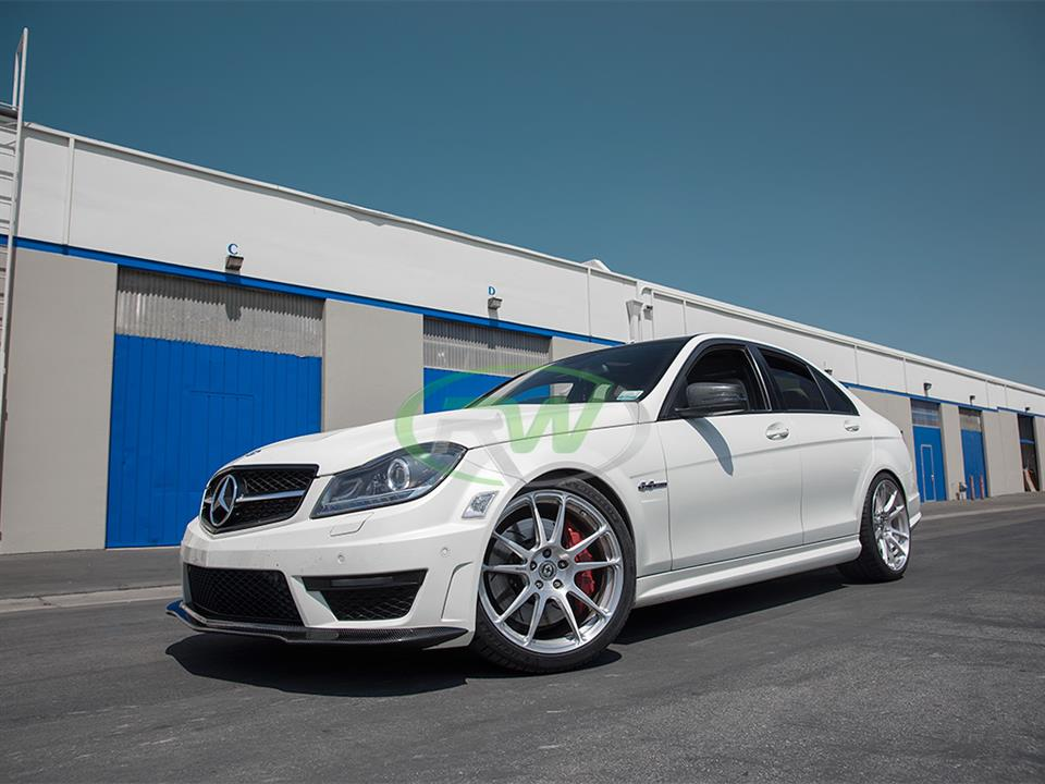 white Mercedes Benz w204 c63 amg sedan with rw carbon fiber black series style cf front lip spoiler