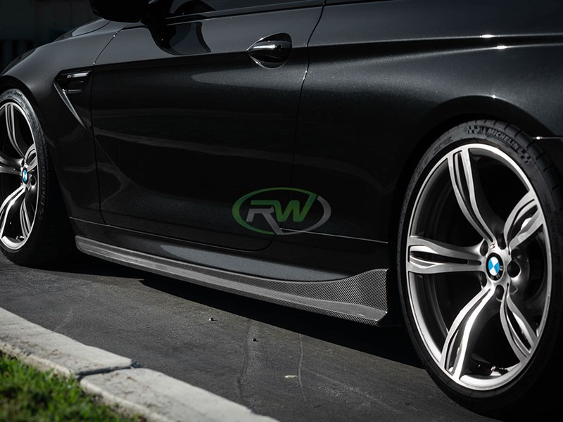 click to view our carbon fiber side skirt extensions for the BMW f06 f12 f13 6 series and M6